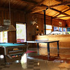 Interior shot of the recreation area and dining room at Yes Bay Lodge in SE Alaska. Photo taken with an Olympus E-500 DSLR with a 14-45 Zoom Lens in multiple shots and stitched into a panorama using Stoik Panarama Maker software.