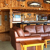 Interior shot of the lounge at Yes Bay Lodge in SE Alaska. Photo taken with an Olympus E-500 DSLR with a 14-45 Zoom Lens in multiple shots and stitched into a panorama using Stoik Panarama Maker software.