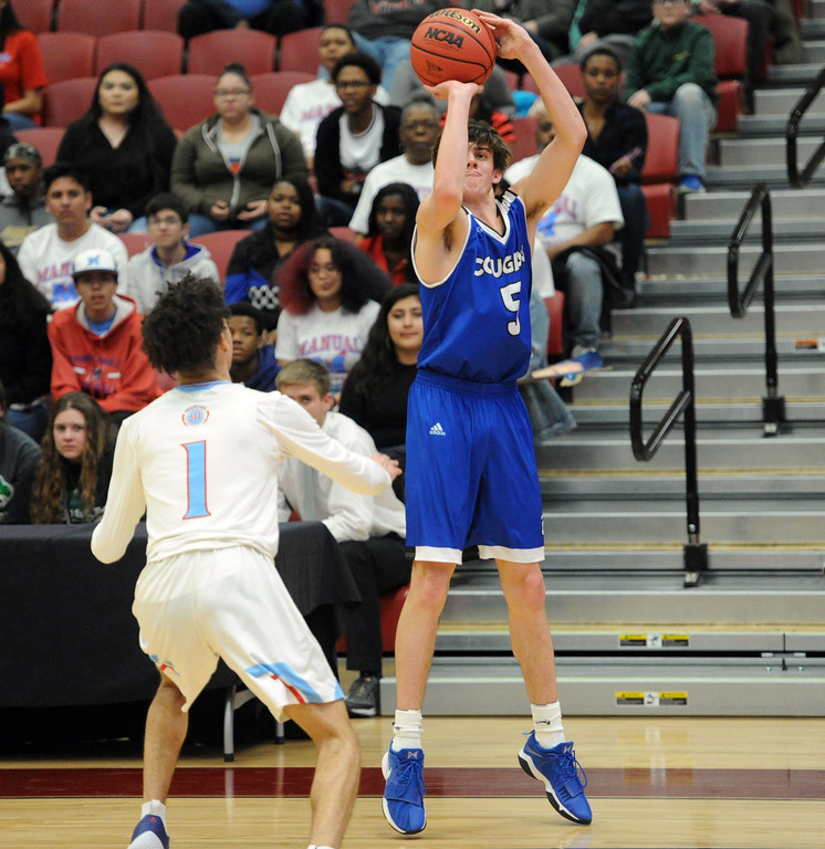 . Reece Johnson shoots a 3-pointer during Resurrection Christian\'s Great 8 game against Manual at Magness Arena on Thursday, March 7. (Colin Barnard/Loveland Reporter-Herald)