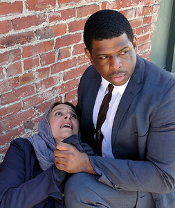 L-R:  Sheila Balter, Khary Moye.  Young Man tries to rescue a stranger.  Photo credit:  Mel Solomon