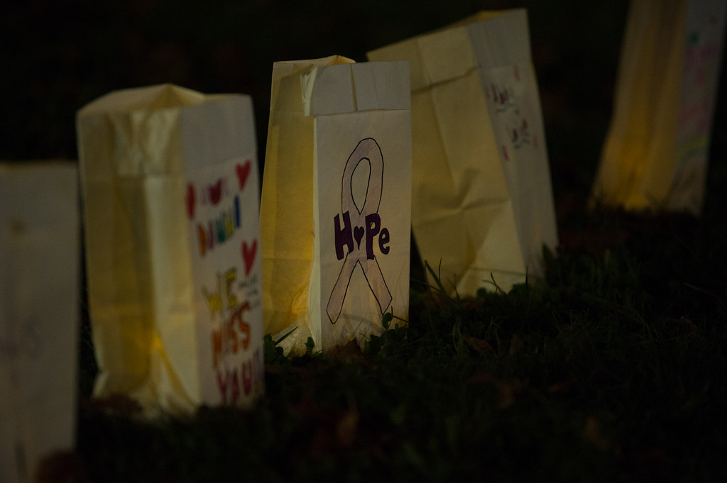 . Luminary bags line the walkway leading to the Lunenburg High School turf field during the All Awareness Cancer Field Hockey Game between North Middlesex and Lunenburg on Monday Oct. 2, 2017. SENTINEL & ENTERPRISE JEFF PORTER