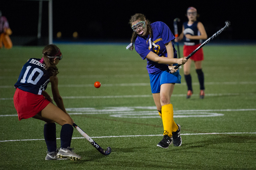 . Abigail Koziol (right) of Lunenburg hits the ball through Emily Hurst of North Middlesex during the All Awareness Cancer Field Hockey Game on Monday Oct. 2, 2017 at Lunenburg High School. SENTINEL & ENTERPRISE JEFF PORTER