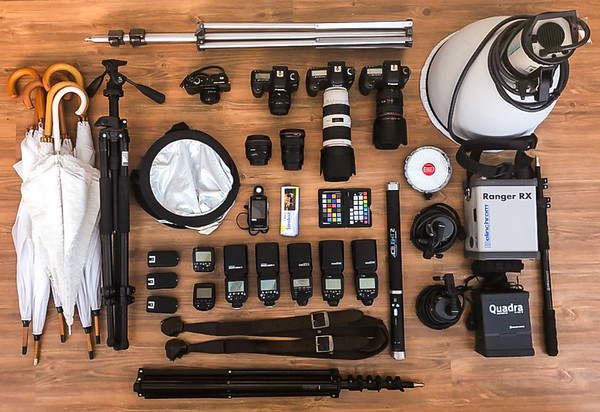 Here's some of the kit for a typical wedding day. Its surprising but most of the kit will be used at some stage during the day, be it the ice light to help in low light bridal preps, or the 'big Bertha' Ranger RX to create stunning twilight images or various flashes for indoor, first dance shots.  Thankfully we don't get too much use out of the umbrellas (apart from a classic backlit brolly shot).