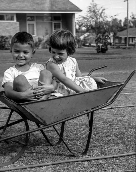 Jan & John In A Wheelbarrow