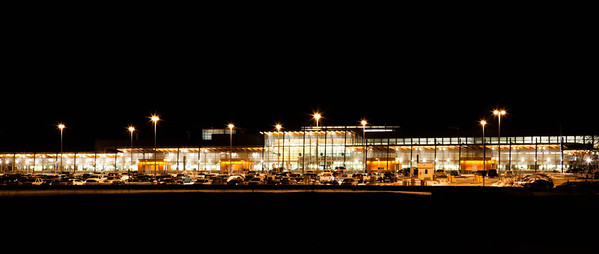 "Week #45, Project 52 – ""Fairbanks International…""  My week 45 photo is a night shot of the Fairbanks International Airport.  The newly re-built terminal received numerous design awards and favorable international press in the design community, so I've read.  It's generally a fairly quite airport in a fairly small community.  Fairbanks is the smallest city in the United States with non-stop service to Europe, as Condor Airlines offers weekly flights to Frankfurt during the summer tourist season.  It wasn't what I had in mind for an evening shoot, but my original plans failed miserably and this was plan B.  But I guess that's the whole idea of a ""Project 52.""   Get out and shoot something."