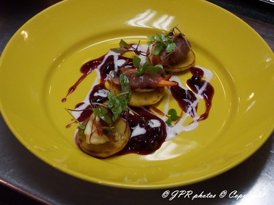 (21) Proscuito-wrapped lobster on sweet potato blinis.  Cassis compote and lemon creme fraiche.