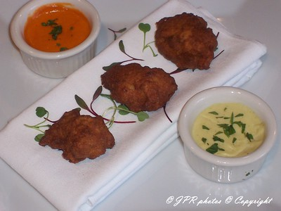 (11)Lobster fritters.  Roast red pepper coulis and artichoke aioli dipping sauces.