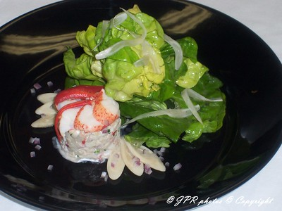 (3) Chilled lobster salad. Bibb lettuce, shaved fennel, hearts of palm, and red onion tossed in pomegranite viniagrette. Bound lobster salad with hearts of palm, red onion, fennel, and chive.