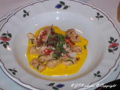 (8) Lobster gnocchi tossed in saffron cream sauce.  Basil chiffinade garnish.  Dish created by Chef Benjamin Fambrough, Sans Souci.
