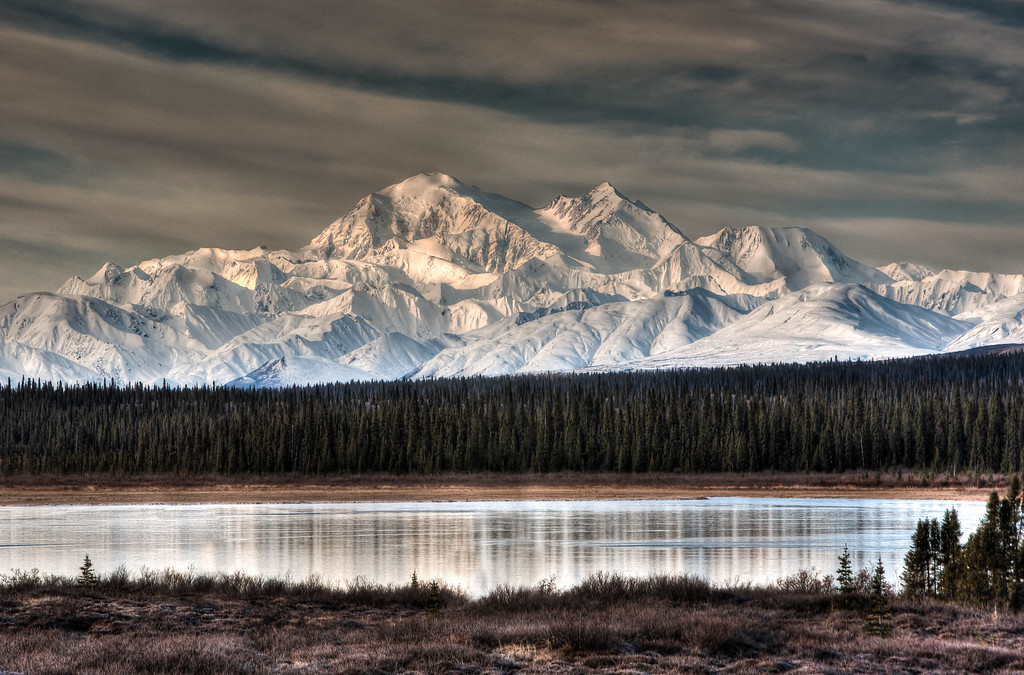 This week's photo is a view of Denali from Broad Pass, just a little south of Cantwell.  The dark barren landscape of the pass in contrast with morning light on the mountain lends itself well to a three exposure HDR.  Within a few days of this shot winter had settled in over much of interior Alaska.
