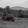 "An old Farmall tractor looks lonely in this field in Dedham, Maine.<br /> <br /> Framed prints of this image area available at  <a href=""http://www.newenglandphotoart.com"">http://www.newenglandphotoart.com</a>"