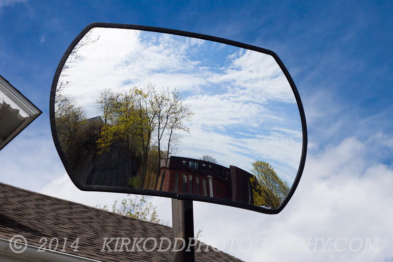 It's not a sign, but this interesting mirror at the top of the hill in Mystic gives a good view of the sky.