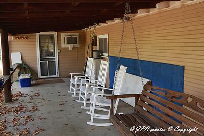 Back porch of larger cabin overlooks creek