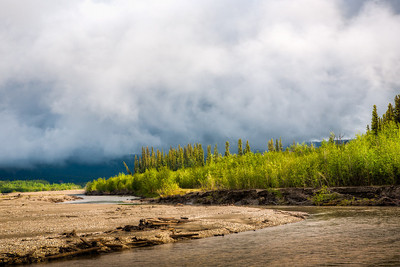 """Week #22, Project 52 – """"Early Morning on the Tanana River...""""  Ventured out to the Tanana River near the airport this morning. Note to self...take bug spray next time. It was a pretty morning.  Mother nature couldn't decide if she wanted to be cloudy or sunny so she mixed in a little of both.  Shot with Canon 5D, 24-70mm at 70mm, 1/125 sec, f/8.0, iso 100.  Three expoures at +/- 2 stops, processed in Photomatix."""