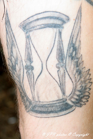 Doug, the Hour Glass and Wings representing on how presious time is and how fast it passes. Left Bicep