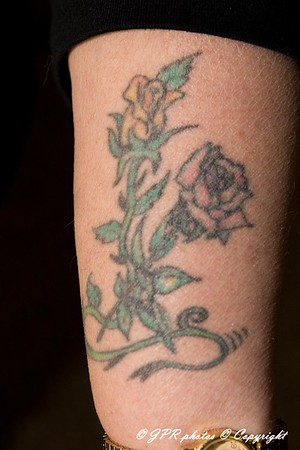 Paulette in her 50's got this one on her left arm in honor of her Mom and Dad