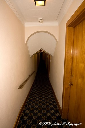 A narrow hall to guest rooms, second floor