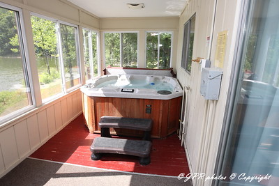 Through the glass doors to the back porch to right your own personnel hot tub.