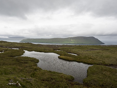 The beautiful scenery as I hiked across the mountain from Tórshavn to Kirkjubøur. The island in the distance is Hestur. You can just about see the one village on it at the bottom centre of the mountain.