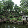 A Chinese Garden - Water, Rocks, Buildings and Plants