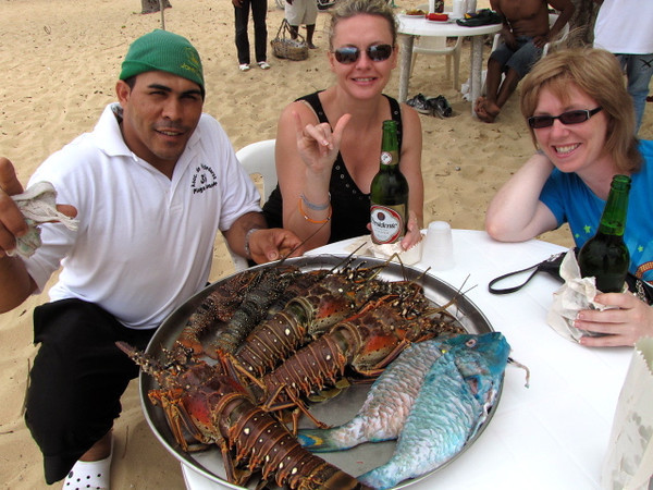 "Yesterday we did a 1.5 hour drive to ""Playa Grande"" Beach for lunch... sounds like a crazy long drive for lunch but we were told for the amazing Lobster there it'd be well worth it... boy oh boy was it!! :-) There's our host, Daniel, bringing out the day's fresh catch to let Nancy & Tanya choose what we'd be having."