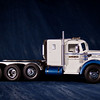 A custom Lmack triple axle truck in the blue diamond color scheme.  The lift axle mechanism works well.
