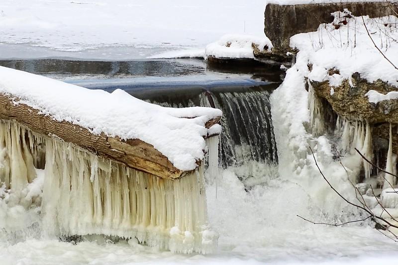 Frozen Falling Water on Fallen Log