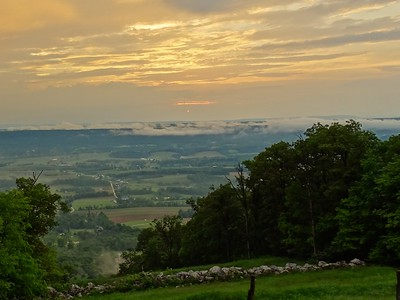 Mist rising from the mountain ranges of Fulton County, PA and beyond, at sunset after a storm.