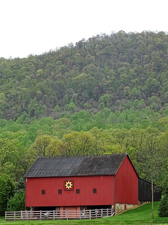 Beautiful barn on Mountain Road near Mercersburg, with early spring green on the mountain in the background.