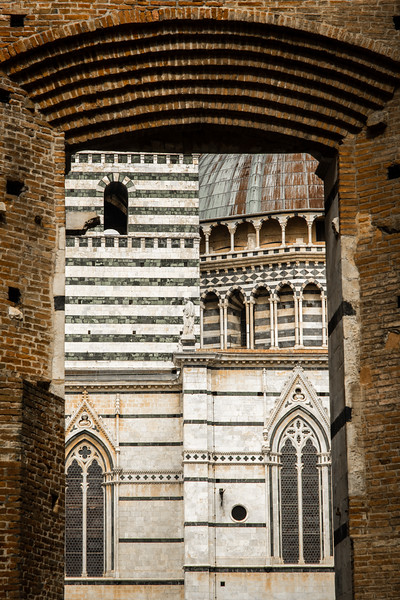 Through the gate offers a collage view of Siena Duomo's multifaceted facade