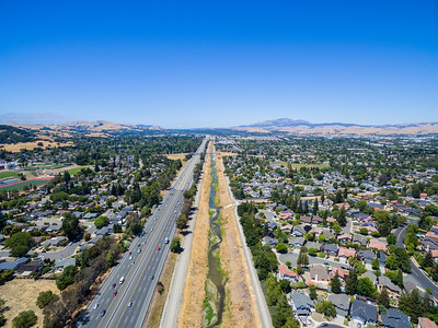 Aerial Scenery. Arroyo de la Laguana & Interstate 680. Also in this photo starting from the front is Pleasanton Canal (Right), Valley Trails Park (Right), Foothill High School (Left), West Las Positas Boulevard (Crosses the canal), Stoneridge Drive (Crosses the canal). Pleasanton, CA, USA