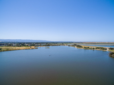 Aerial Scenery. Shoreline Lake. In the distance in the center is Casey Forebay. On the right in the distance is Shoreline Slough & Charleston Slough. Shoreline Park - Mountain View, CA, USA