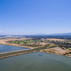 Aerial Scenery. Starting from the bottom, Shoreline Slough, Mountain View Slough, Shoreline Lake (on the right slightly cut off), Shoreline Golf Links, Shoreline Amphitheatre (tent like object in the distance), and NASA Moffett Field (left). Shoreline Park - Mountain View, CA, USA