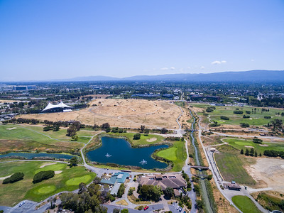 Aerial Scenery. Shoreline Golf Links, Mountain View Slough (1/3 of the way from the right), Shoreline Amphitheatre (tent like object on the left), and NASA Moffett Field (left). Shoreline Park - Mountain View, CA, USA