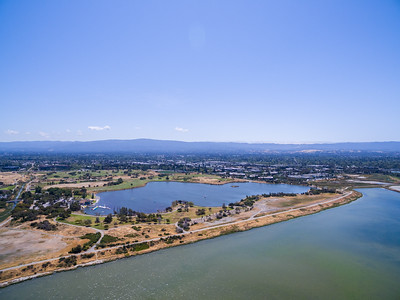 Aerial Scenery. Shoreline Lake. Also in photo, Shoreline Slough (foreground), Mountain View Slough (left), and Shoreline Golf Links (in the distance). Shoreline Park - Mountain View, CA, USA