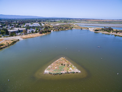 Aerial Scenery. Island in Shoreline Lake. In the middle off in the distance is Casey Forebay and Egret Pond. On the right in the distance is Shoreline Slough & Charleston Slough. Shoreline Park - Mountain View, CA, USA