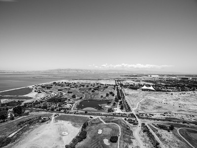 Aerial Scenery. Shoreline Golf Links, Mountain View Slough (1/3 of the way from the bottom), Shoreline Amphitheatre (tent like object on the right), and NASA Moffett Field (right). Shoreline Park - Mountain View, CA, USA