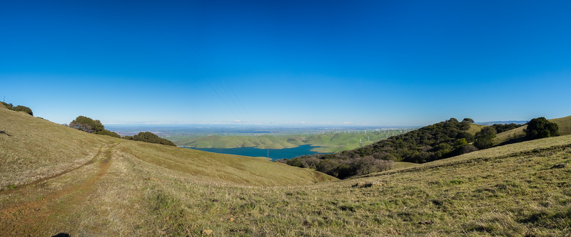 Panorama. Los Vaqueros Reservoir, Discovery Bay (left), Clifton Court Forebay (slightly left from center), Tracy (right). Whipsnake Loop Trail. Los Vaqueros Watershed - Contra Costa County, CA, USA