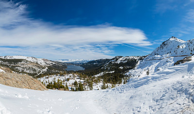 Panorama. Donner Lake. Abandoned Historical Central Pacific Railroad Tunnels in on side of mountain on the right. Donner Summit Bridge Vista Point on side of Donner Pass Road - Truckee, CA, USA