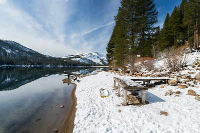 Donner Lake. Abandoned Historical Central Pacific Railroad Tunnels on the mountain in the middle. Pier on side of Donner Pass Road - Truckee, CA, USA