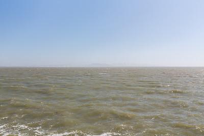 View of Bay Bridge, San Francisco, Treasure Island, and Yerba Buena Island. Near Berkeley Pier - Berkeley, CA, USA