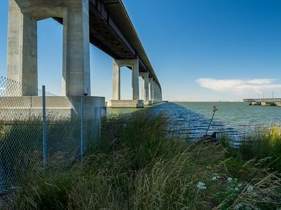 Antioch, CA (foreground), Windmills in Rio Vista, CA (in the distance), Antioch Bridge (left), Fishing Pier (right), Sacramento-San Joaquin River Delta (water). Antioch/Oakley Regional Shoreline. Antioch, CA, USA
