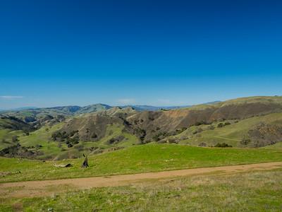 San Francisco, CA (in the distance on the left), Tri-Valley & Mt. Diablo (in the distance on the right). Cerro Este Road. Sunol Regional Wilderness. Sunol, CA, USA