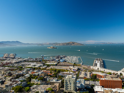 Foreground: Fishermans Wharf (left), Pier 39 (center), Piers (left) In the distance: North Bay (center & left), Alcatraz Island & Angel Island (slightly left from center), Richmond-San Rafael Bridge (right)  On top of Coit Tower. San Francisco, CA, USA