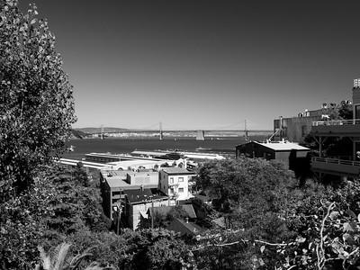 Piers, Bay Bridge, and Yerba Buena Island (left). Climbing Greenwich Steps to Coit Tower. Montgomery Street. San Francisco, CA, USA