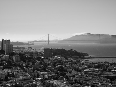 Golden Gate Bridge (in the distance in the center) & Presidio (left)  On top of Coit Tower. San Francisco, CA, USA