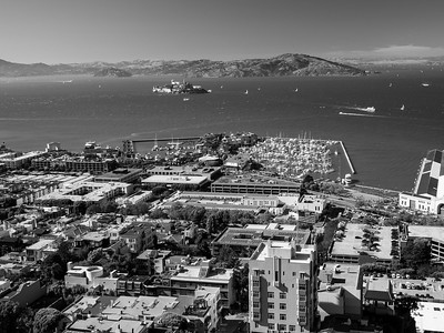 Foreground: Pier 39 In the distance: North Bay (top center & top left), Alcatraz Island & Angel Island (slightly left from top center), Richmond-San Rafael Bridge (top right)  On top of Coit Tower. San Francisco, CA, USA