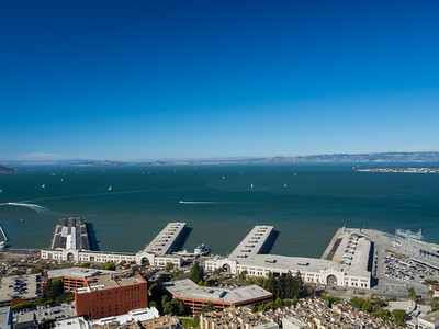 Foreground: Piers In the distance: Richmond-San Rafael Bridge (left), Richmond, CA (center and right), Treasure Island (right)  On top of Coit Tower. San Francisco, CA, USA
