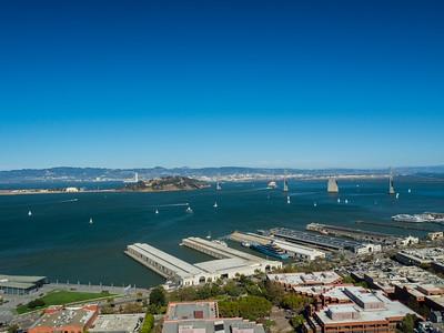 Piers (foreground), Bay Bridge (background), Yerba Buena Island & Treasure Island (left)  On top of Coit Tower. San Francisco, CA, USA