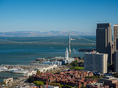 San Francisco Ferry Building, Piers, and Bay Bridge  On top of Coit Tower. San Francisco, CA, USA